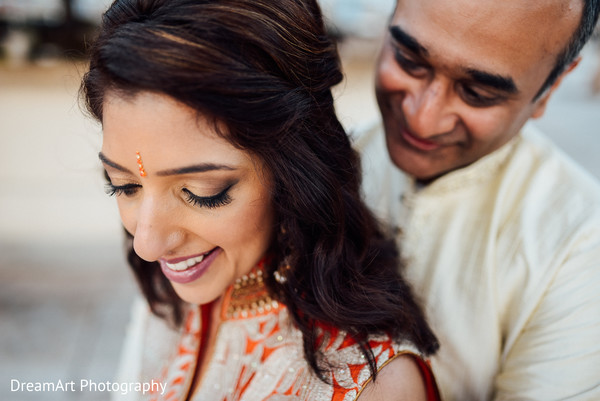 Indian groom hugging the bride photography