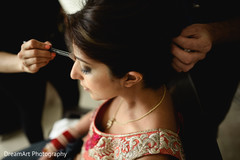 Indian bride getting ready for wedding ceremony