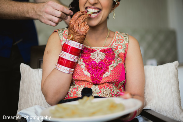 Indian bride eating a snack before wedding ceremony