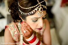 Lovely indian bride getting ready for wedding ceremony
