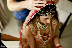Beautiful indian bride getting ready photography