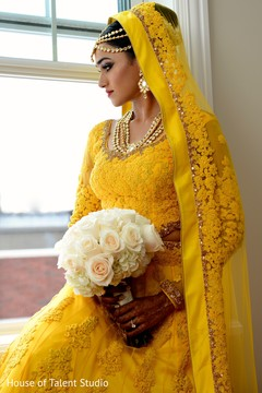 yellow wedding lengha,indian bride,indian bridal hair and makeup,indian bride getting ready