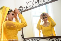 Indian bride glowing in her yellow wedding attire.