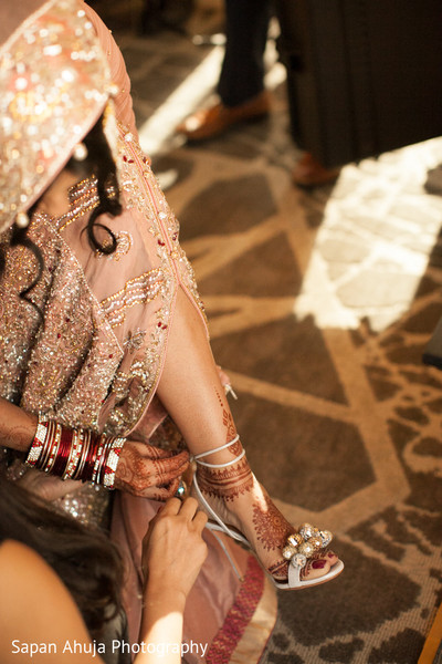 pakistani bride,indian bride getting ready,indian wedding shoes