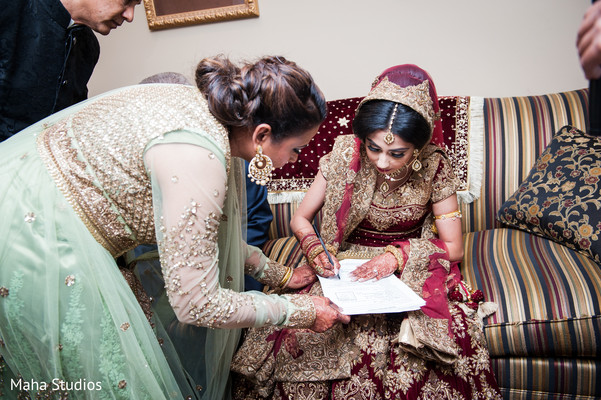 Bride signing the marriage contract.
