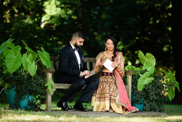 Lovely bride and groom reading each others letters.