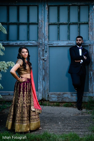 Indian bride and groom glamorous reception outfits.