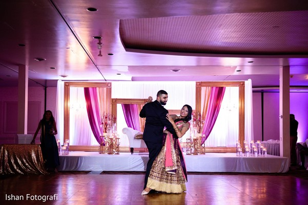 Indian bride and groom dance.