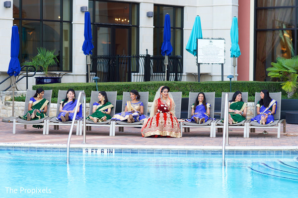 Maharani and bridesmaids by the pool in Rockwall, TX Indian Wedding by The Propixels