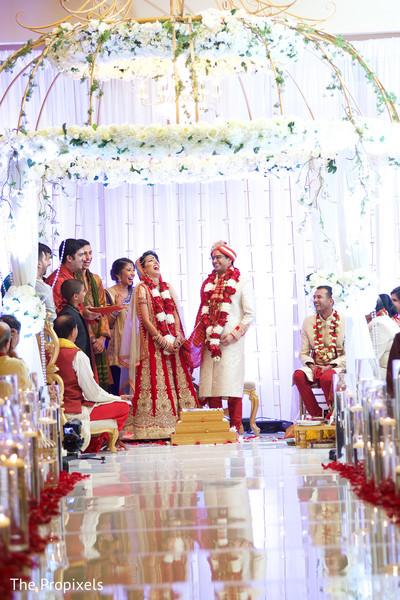 Indian couple enjoying wedding ceremony