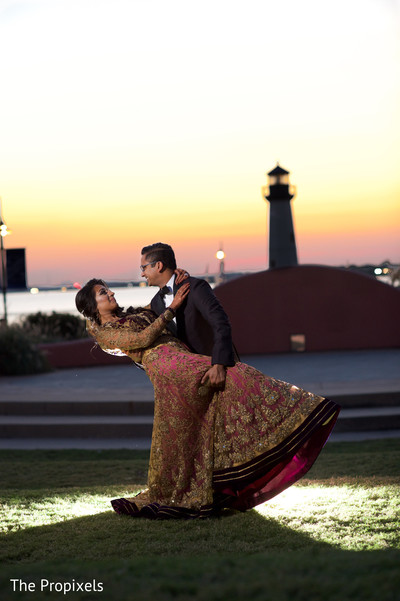 Lovely gold and purple bridal lengha in Rockwall, TX Indian Wedding by The Propixels