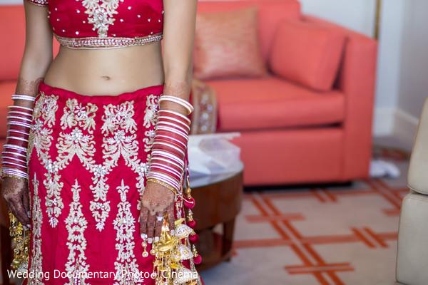 Indian bride lengha, bangles and mehndi art