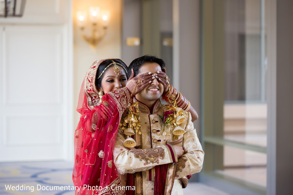 Indian bride covering grooms eyes photography