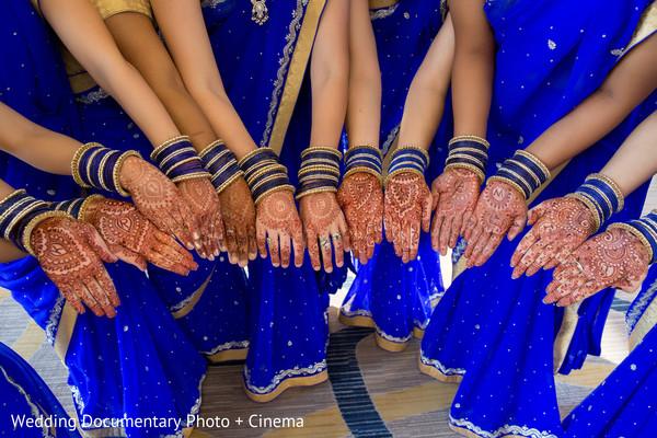 Indian bridesmaids showing their mehndi art photography