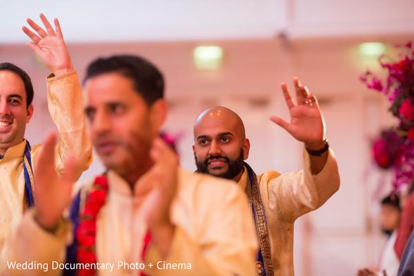 Indian groomsmen arriving at wedding ceremony