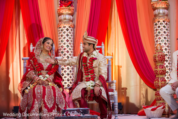 Indian couple smiling photography at wedding ceremony