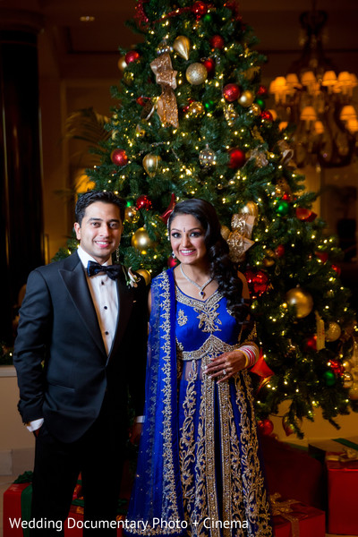 Indian couple and christmas tree photography at wedding reception