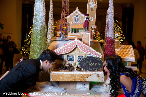 Indian couple eating a gingerbread house photography