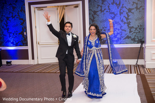 Indian couple arriving at wedding reception