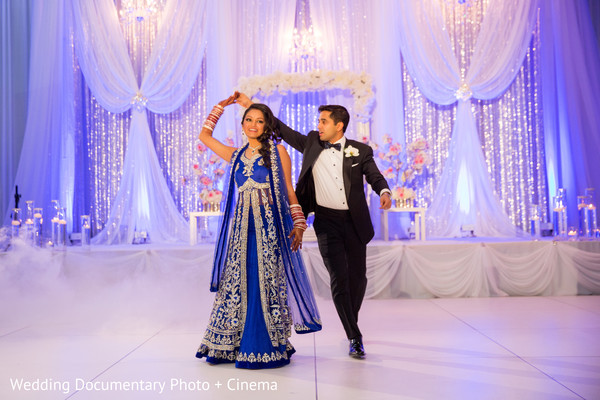 Beautiful indian couple dancing at wedding reception