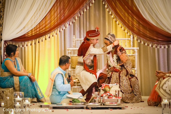 Groom giving necklace