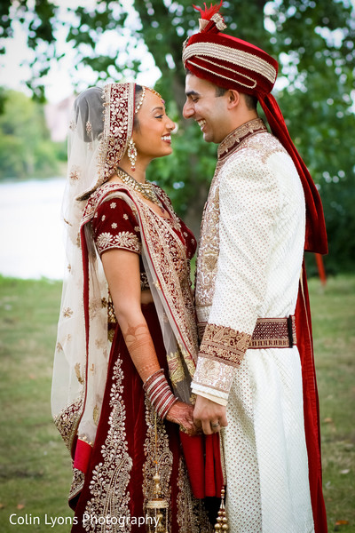 Indian couple in their wedding ceremony outfits