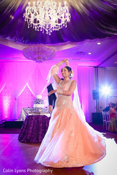 indian bride and groom first dance,indian wedding gowns,indian fusion wedding reception