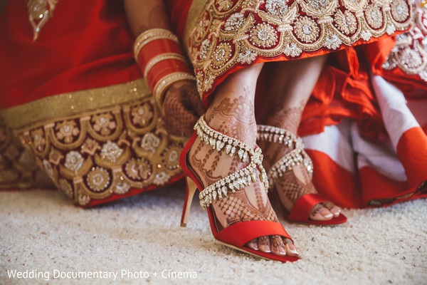 Indian bride trying her shoes before wedding ceremony in California Sikh Wedding by Wedding Documentary Photo + Cinema