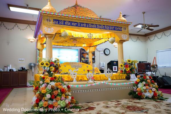 Yellow mandap at indian wedding ceremony in California Sikh Wedding by Wedding Documentary Photo + Cinema