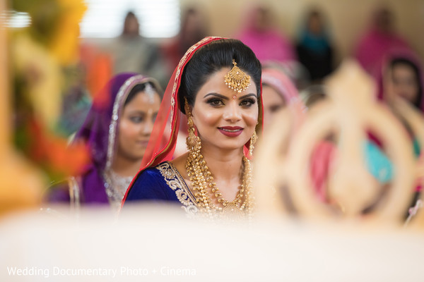 Beautiful indian bride at wedding ceremony in California Sikh Wedding by Wedding Documentary Photo + Cinema