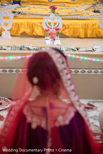 Indian bride in the middle of wedding ceremony in California Sikh Wedding by Wedding Documentary Photo + Cinema