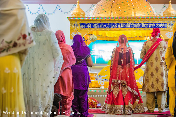 Everybody praying at indian wedding ceremony