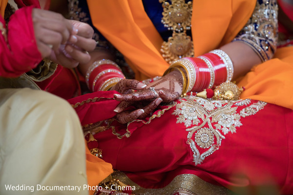 Indian couple exchanging rings at wedding ceremony in California Sikh Wedding by Wedding Documentary Photo + Cinema