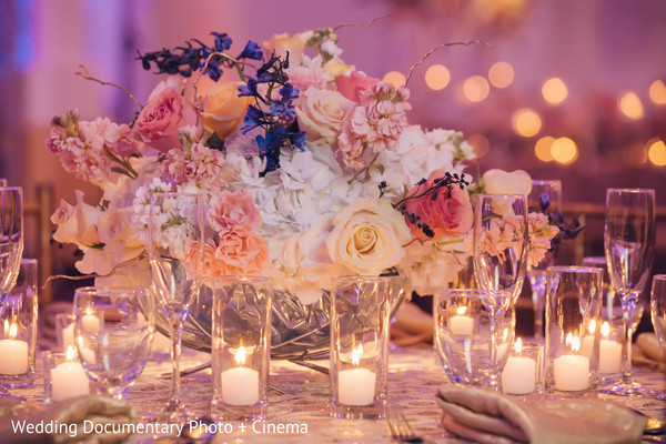 Beautiful flower centerpieces at indian wedding reception in California Sikh Wedding by Wedding Documentary Photo + Cinema
