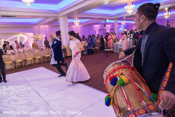 Indian couple getting to the dancefloor at wedding reception in California Sikh Wedding by Wedding Documentary Photo + Cinema