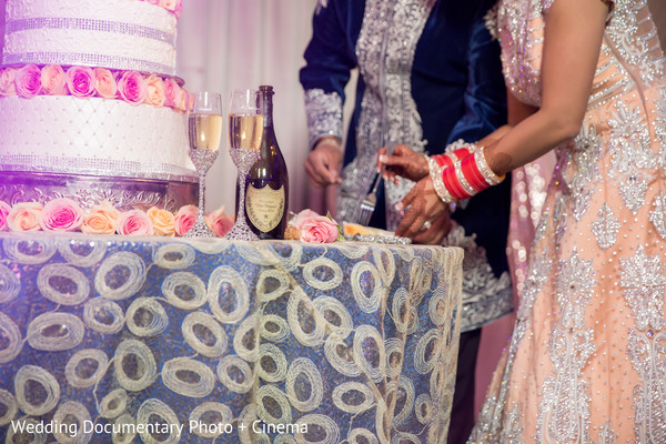 Indian couple eating cake at wedding reception in California Sikh Wedding by Wedding Documentary Photo + Cinema