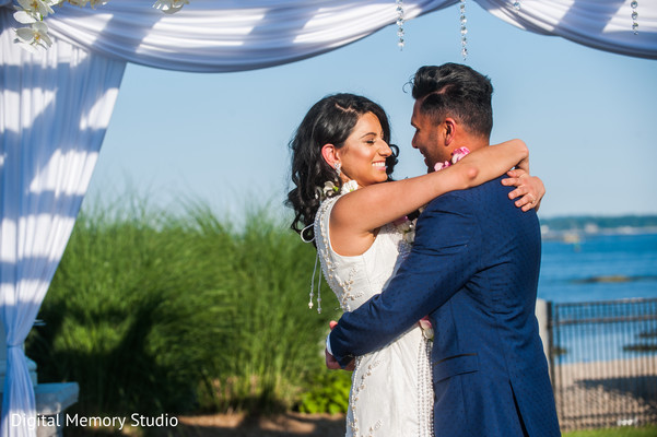 Indian couple hugging at wedding ceremony in New York Wedding by Digital Memory Studio