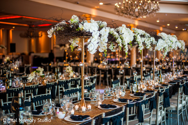 Floral centerpieces at indian wedding reception in New York Wedding by Digital Memory Studio