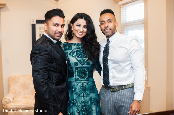Indian couple and a friend photography before wedding reception
