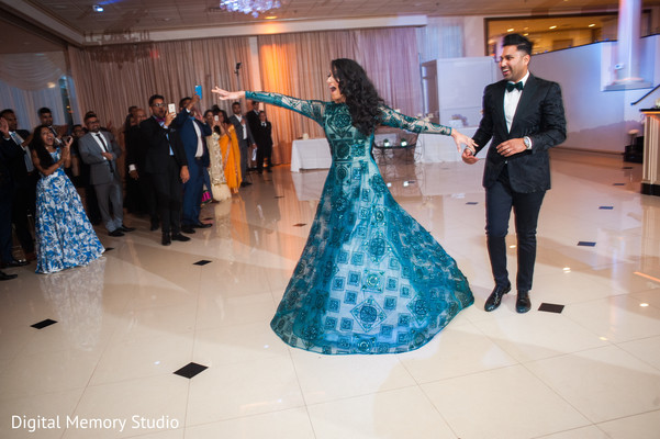 Indian couple about to have their first dance at wedding reception in New York Wedding by Digital Memory Studio