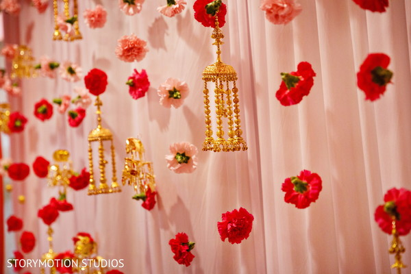 Carnations decorating the wedding ceremony. in New Rochelle, NY Sikh Wedding by StoryMotion Studios