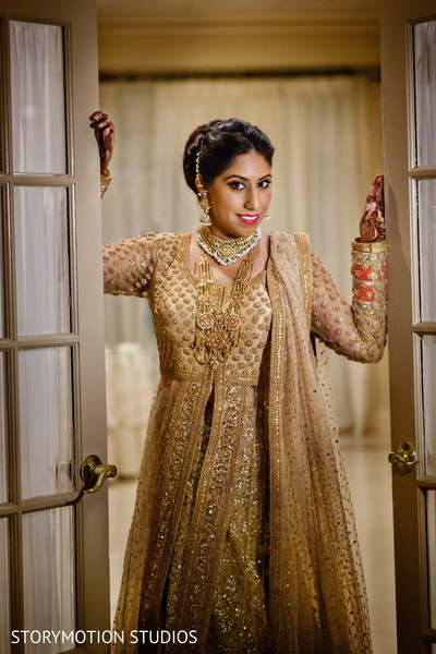 Sikh bride golden look. in New Rochelle, NY Sikh Wedding by StoryMotion Studios