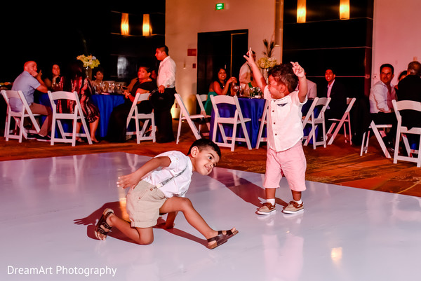 Indian kids dancing at wedding reception in Playa Del Carmen, Mexico Wedding by DreamArt Photography