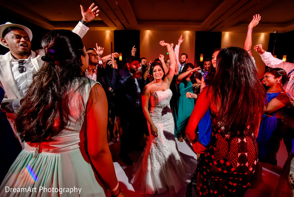 Indian couple and guests dancing at wedding reception in Playa Del Carmen, Mexico Wedding by DreamArt Photography