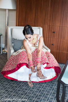 indian bride getting ready,indian bride,indian bridal fashions,indian wedding shoes