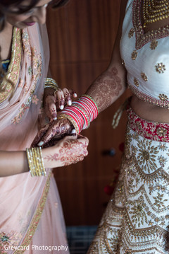 indian bride getting ready,indian bride,indian bridal fashions,indian bridal bangles