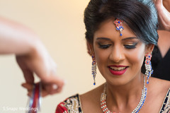 indian bride getting ready,indian bride,indian bridal hair and makeup