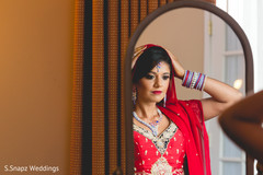 indian bride,indian bride getting ready,indian bridal hair and makeup