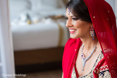 indian bride,indian bride getting ready,indian bridal hair and makeup,dupatta