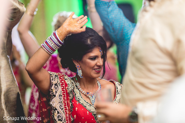 Indian bride at the wedding reception. in Long Island, NY Fusion Wedding by S.Snapz Weddings